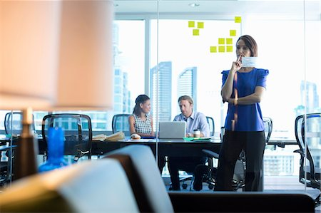Business people working in office Stock Photo - Premium Royalty-Free, Code: 614-06624395