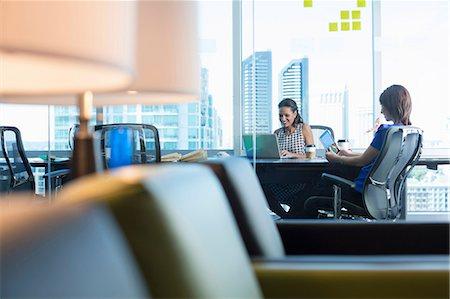 Businesswomen working at desk Stock Photo - Premium Royalty-Free, Code: 614-06624391