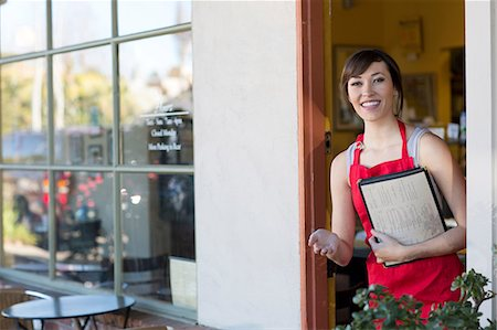 Waitress standing at cafe door Stock Photo - Premium Royalty-Free, Code: 614-06624456