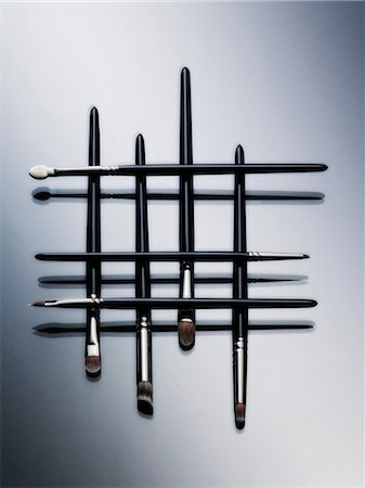 Makeup brushes arranged in pattern Stock Photo - Premium Royalty-Free, Code: 614-06624478