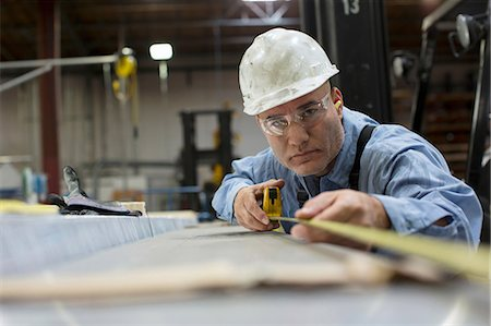 Worker measuring in metal plant Stock Photo - Premium Royalty-Free, Code: 614-06624481
