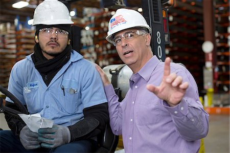 Worker and businessman in metal plant Stock Photo - Premium Royalty-Free, Code: 614-06624543