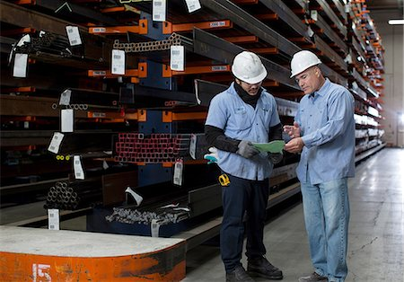 Workers talking in metal plant Stock Photo - Premium Royalty-Free, Code: 614-06624553