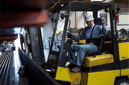 Worker using forklift in metal plant Stock Photo - Premium Royalty-Free, Code: 614-06624564