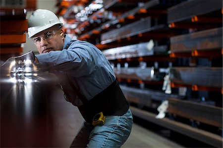 Worker using machinery in metal plant Stock Photo - Premium Royalty-Free, Code: 614-06624562