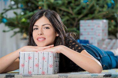 Teenage girl with Christmas present Stock Photo - Premium Royalty-Free, Code: 614-06624584