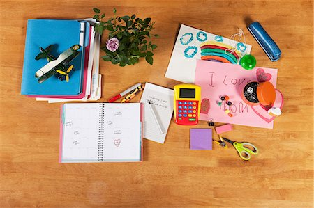Child's notebooks, pens and toys Stock Photo - Premium Royalty-Free, Code: 614-06624610