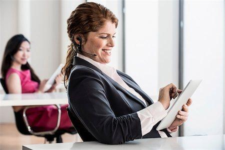Businesswoman using tablet computer Stock Photo - Premium Royalty-Free, Code: 614-06624628