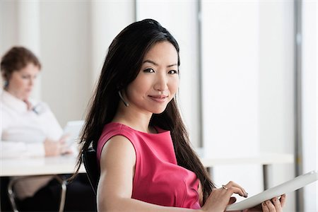 Businesswoman using tablet computer Stock Photo - Premium Royalty-Free, Code: 614-06624630