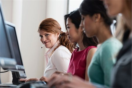 switchboard operator - Businesswomen working at computers Stock Photo - Premium Royalty-Free, Code: 614-06624658