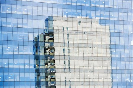Skyscraper reflected in windows Stock Photo - Premium Royalty-Free, Code: 614-06624676