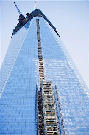 Scaffolding on urban skyscraper Stock Photo - Premium Royalty-Free, Code: 614-06624685