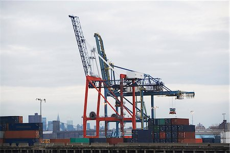 Crane and containers on loading dock Stock Photo - Premium Royalty-Free, Code: 614-06624696