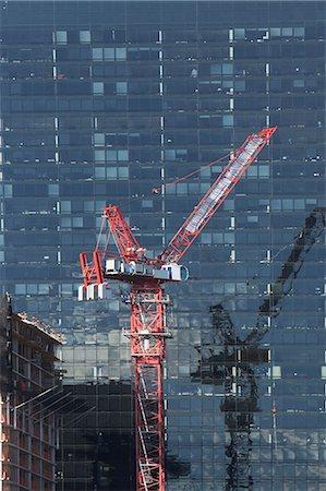 Crane by urban skyscraper Stock Photo - Premium Royalty-Free, Code: 614-06624724