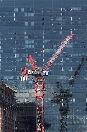 Crane by urban skyscraper Stock Photo - Premium Royalty-Free, Code: 614-06624724
