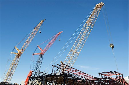 Colorful cranes against blue sky Stock Photo - Premium Royalty-Free, Code: 614-06624736