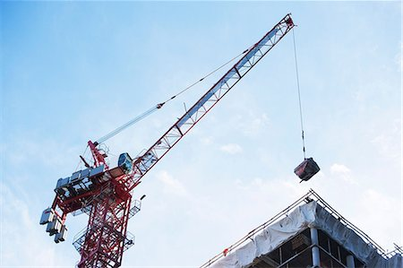 equipment - Crane loading equipment on building Stock Photo - Premium Royalty-Free, Code: 614-06624737