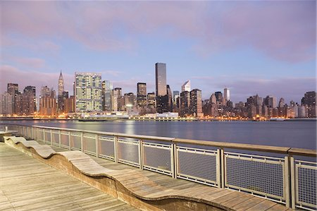 New York City skyline lit up at dusk Stock Photo - Premium Royalty-Free, Code: 614-06624750