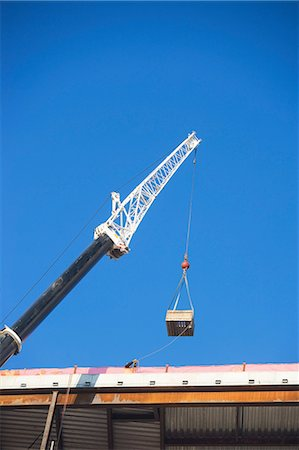 Crane loading equipment on building Stock Photo - Premium Royalty-Free, Code: 614-06624774
