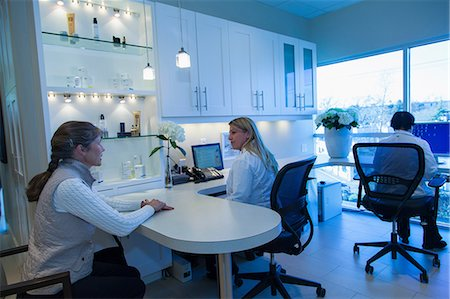 Doctor and patient talking in office Stock Photo - Premium Royalty-Free, Code: 614-06624817