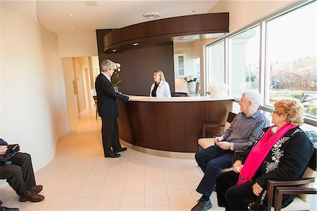 Patients in doctor's waiting room Stock Photo - Premium Royalty-Free, Code: 614-06624819