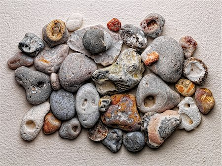 Sea stones arranged on paper Stock Photo - Premium Royalty-Free, Code: 614-06624827