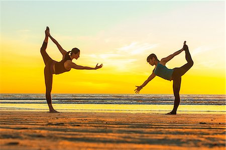 flexible (people or objects with physical bendability) - Women practicing yoga on beach Stock Photo - Premium Royalty-Free, Code: 614-06624834