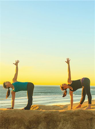 Women practicing yoga on rock formation Stock Photo - Premium Royalty-Free, Code: 614-06624832