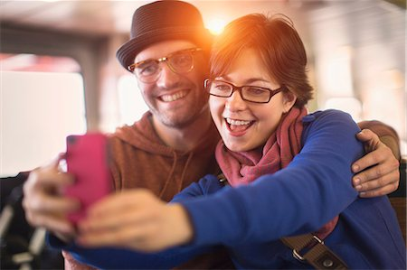Couple taking picture with cell phone Stock Photo - Premium Royalty-Free, Code: 614-06625004