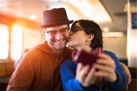 Couple taking picture with cell phone Stock Photo - Premium Royalty-Free, Code: 614-06625005