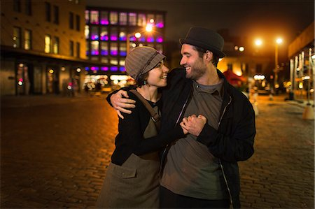 Couple hugging on city street Stock Photo - Premium Royalty-Free, Code: 614-06625027