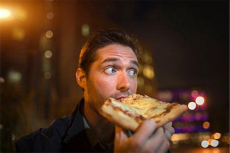 eating - Man eating pizza on city street Stock Photo - Premium Royalty-Free, Code: 614-06625021