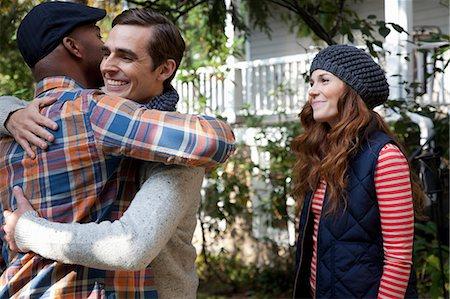 friendship - Smiling men hugging outdoors Stock Photo - Premium Royalty-Free, Code: 614-06625068