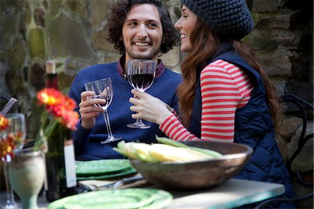 Couple having wine together outdoors Stock Photo - Premium Royalty-Free, Code: 614-06625081