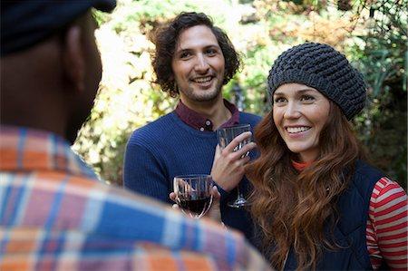 friendship - Smiling friends having wine outdoors Stock Photo - Premium Royalty-Free, Code: 614-06625083
