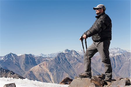 Hiker overlooking snowy mountains Stock Photo - Premium Royalty-Free, Code: 614-06625121