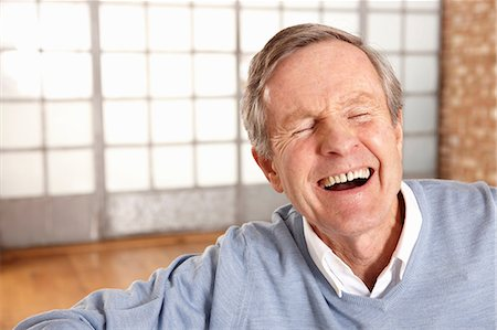 Close up of older man's laughing face Stock Photo - Premium Royalty-Free, Code: 614-06625186