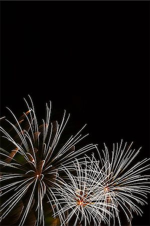 Fireworks exploding in sky Stock Photo - Premium Royalty-Free, Code: 614-06625212