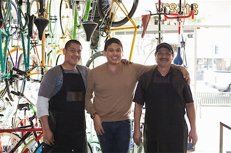 Mechanics smiling in bicycle shop Stock Photo - Premium Royalty-Free, Code: 614-06625225