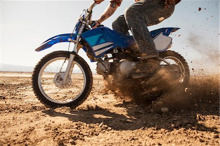 dirt - Man riding dirt bike in desert Stock Photo - Premium Royalty-Free, Code: 614-06625243