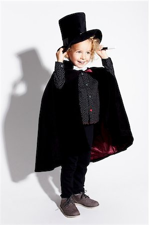 Boy wearing magician costume Stock Photo - Premium Royalty-Free, Code: 614-06625266