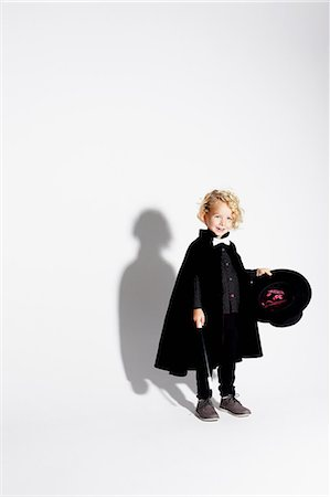 Boy wearing magician costume Stock Photo - Premium Royalty-Free, Code: 614-06625267