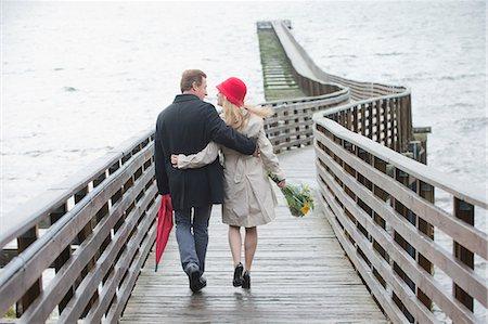 romanticism - Couple walking on wooden dock Stock Photo - Premium Royalty-Free, Code: 614-06625297
