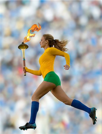 Brazilian runner carrying Olympic torch Stock Photo - Premium Royalty-Free, Code: 614-06625325