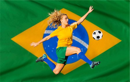 south american woman - Brazilian soccer player by flag Stock Photo - Premium Royalty-Free, Code: 614-06625328