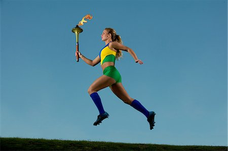 Brazilian runner carrying Olympic torch Stock Photo - Premium Royalty-Free, Code: 614-06625336