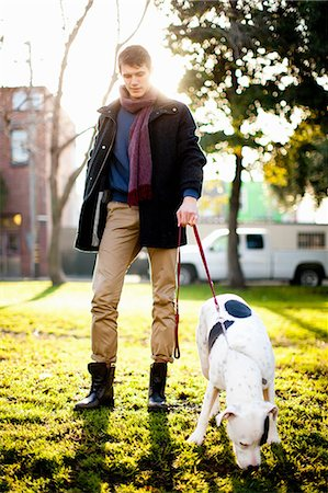 dogs in nature - Man walking dog in park Stock Photo - Premium Royalty-Free, Code: 614-06625432