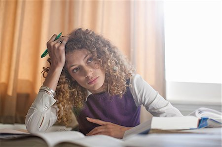 person overwhelmed stresss - Bored woman studying at desk Stock Photo - Premium Royalty-Free, Code: 614-06623349