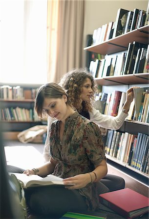 studying (all students) - Students reading books in library Stock Photo - Premium Royalty-Free, Code: 614-06623343
