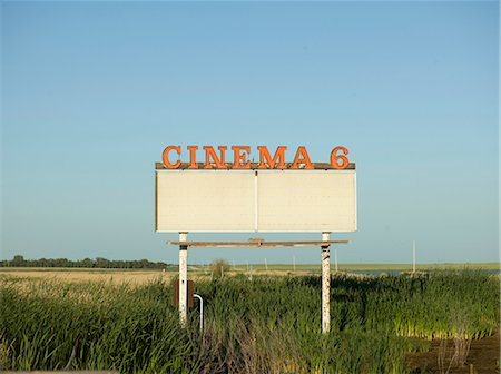 sign - Abandoned drive-in movie sign in field Stock Photo - Premium Royalty-Free, Code: 614-06623352